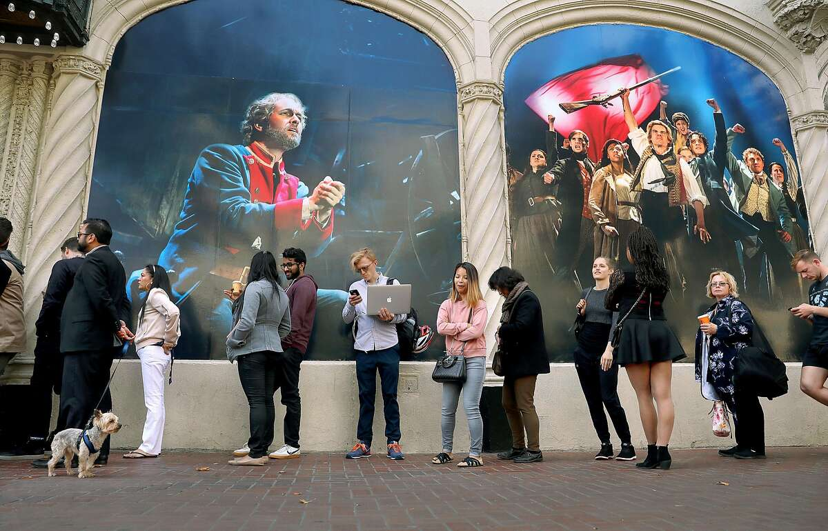 A line waits outside of the Orpheum Theater on Market Street on Tuesday, Aug. 14, 2018 in San Francisco, Calif.