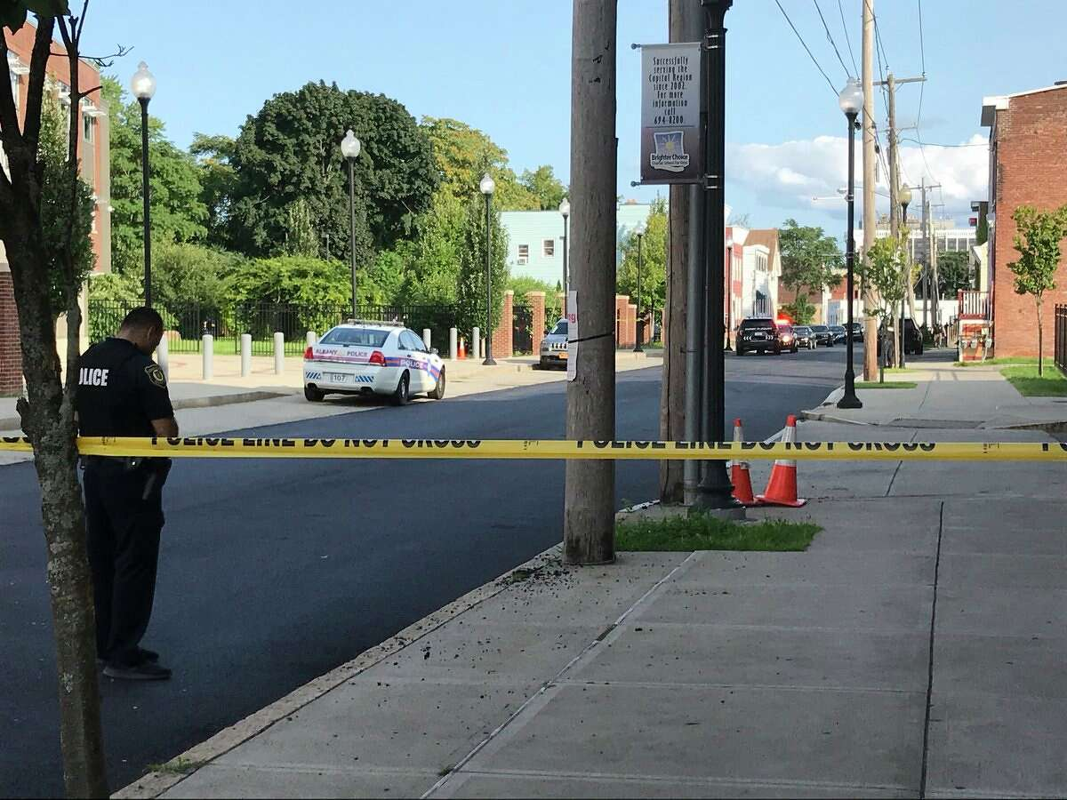 City police set up a perimeter on Elk Street, where an officer fired their gun while on the job Monday, Aug. 30, 2018.