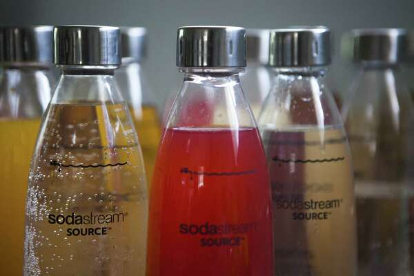 In this Sept. 2, 2015 file photo, SodaStream products are seen at the SodaStream factory near the Bedouin city of Rahat, Southern Israel. Beverage giant PepsiCo has bought Israel's fizzy drink maker SodaStream for $3.2 billion. PepsiCo said on Monday, Aug. 20, 2018, that it is acquiring all SodaStream's outstanding shares at $144 per share, a 32 percent premium to the 30-day volume weighted average price.