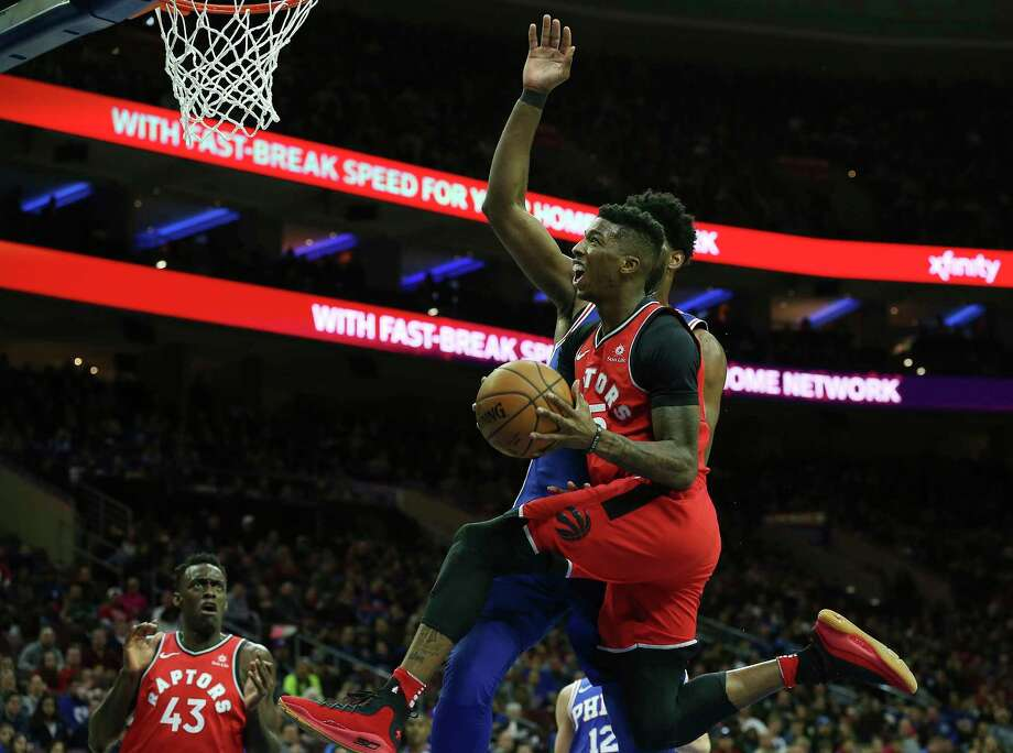 Bruno Caboclo drives to the basket against the 76ers Photo: Associated Press, AP / FR27227 AP