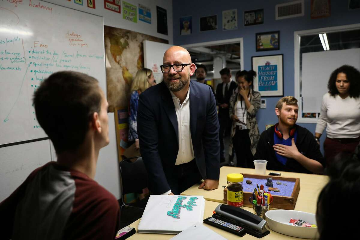 Supervisor Rafael Mandelman (center) introduces himself to Anubis Daugherty, 24 (left) during a tour of the Larkin Street Youth Services in San Francisco, California, on Thursday, Aug. 16, 2018.