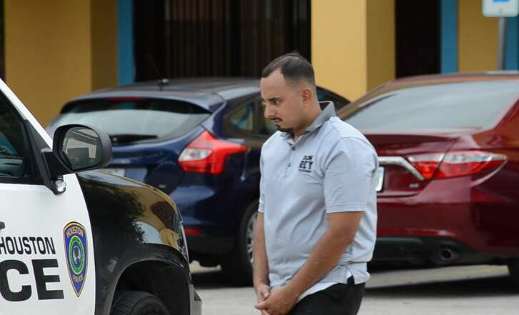 The father of a 3-year-old girl found locked inside her father's vehicle nearly all day Monday, Aug. 20, 2018, waits to speak with police.