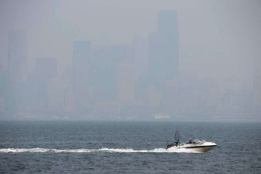 Downtown Seattle is barely visible from West Seattle as wildfire smoke continues to cloud the city, on Monday, Aug. 20, 2018.