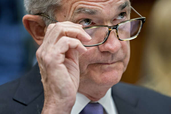 Federal Reserve Chairman Jerome Powell removes his glasses during a House Financial Services Committee hearing in Washington on July 18, 2018.