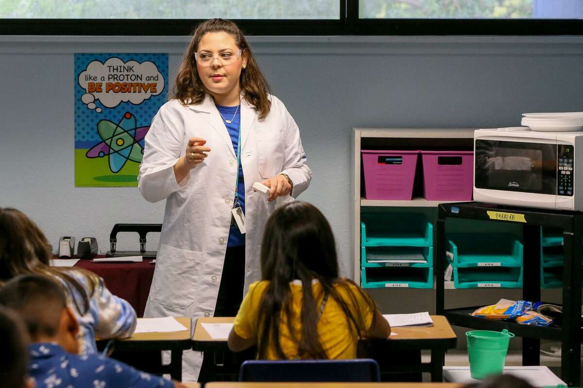 """Ashley Barrera prepares to conduct a """"Soap SoufflŽ"""" experiment, asking her students to predict the effect of heating a bar of ivory soap in a microwave and then discussing the result afterwards, in her 6th-grade Advanced STEM Science class Dwight Middle School on the first day of school on Monday, Aug. 20, 2018. Hundreds of students, about half of all South San incoming sixth graders, have enrolled in the middle school academies, which will allow students to specialize in STEM, health science or fine arts and challenge them with advanced coursework."""