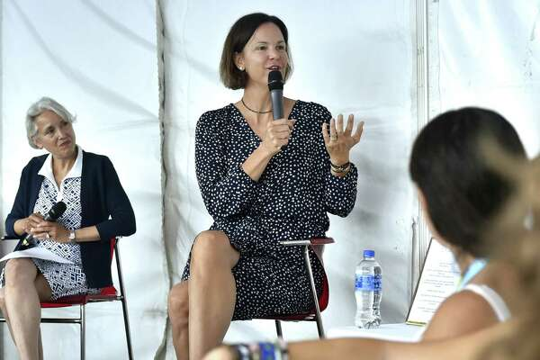 Retired WTA tennis player Lindsay Davenport, right, speaks to high school girls during the 6th Annual Anthem Girls Symposium Monday at the Connecticut Open. At left, is Jill Hummel, President and General Manager of Anthem Blue Cross & Blue Shield of Connecticut.
