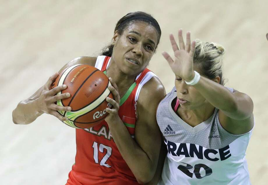 Belarus guard Lindsey Harding (12) runs into France guard Amel Bouderra (20) during the first half of a women's basketball game at the Youth Center at the 2016 Summer Olympics in Rio de Janeiro, Brazil, Sunday, Aug. 7, 2016. (AP Photo/Carlos Osorio) Photo: Associated Press, STF / AP / Copyright 2016 The Associated Press. All rights reserved. This material may not be published, broadcast, rewritten or redistribu