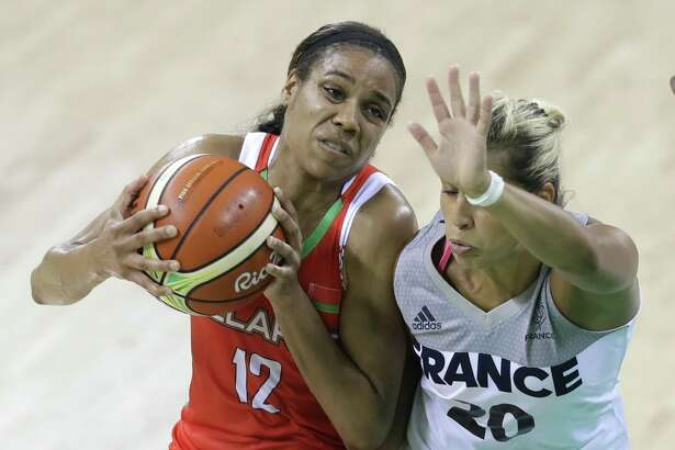 Belarus guard Lindsey Harding (12) runs into France guard Amel Bouderra (20) during the first half of a women's basketball game at the Youth Center at the 2016 Summer Olympics in Rio de Janeiro, Brazil, Sunday, Aug. 7, 2016. (AP Photo/Carlos Osorio)