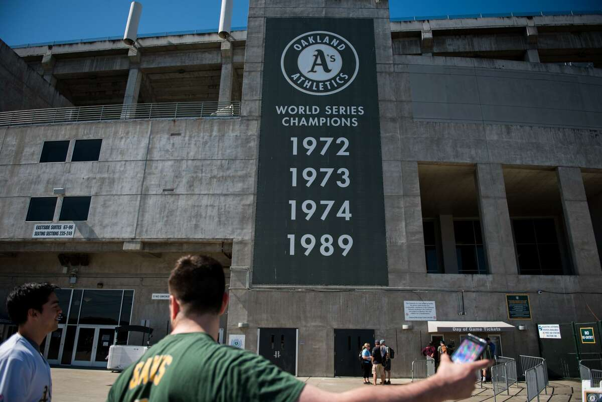 Fans gather at the Oakland Coliseum on Thursday, March 29, 2018, ahead of the opening game.