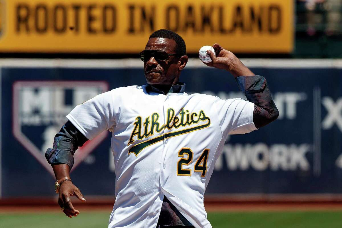 OAKLAND, CA - JULY 22: Former Oakland Athletics outfielder Rickey Henderson throws out the ceremonial first pitch before the game against the San Francisco Giants at the Oakland Coliseum on July 22, 2018 in Oakland, California. (Photo by Jason O. Watson/Getty Images)