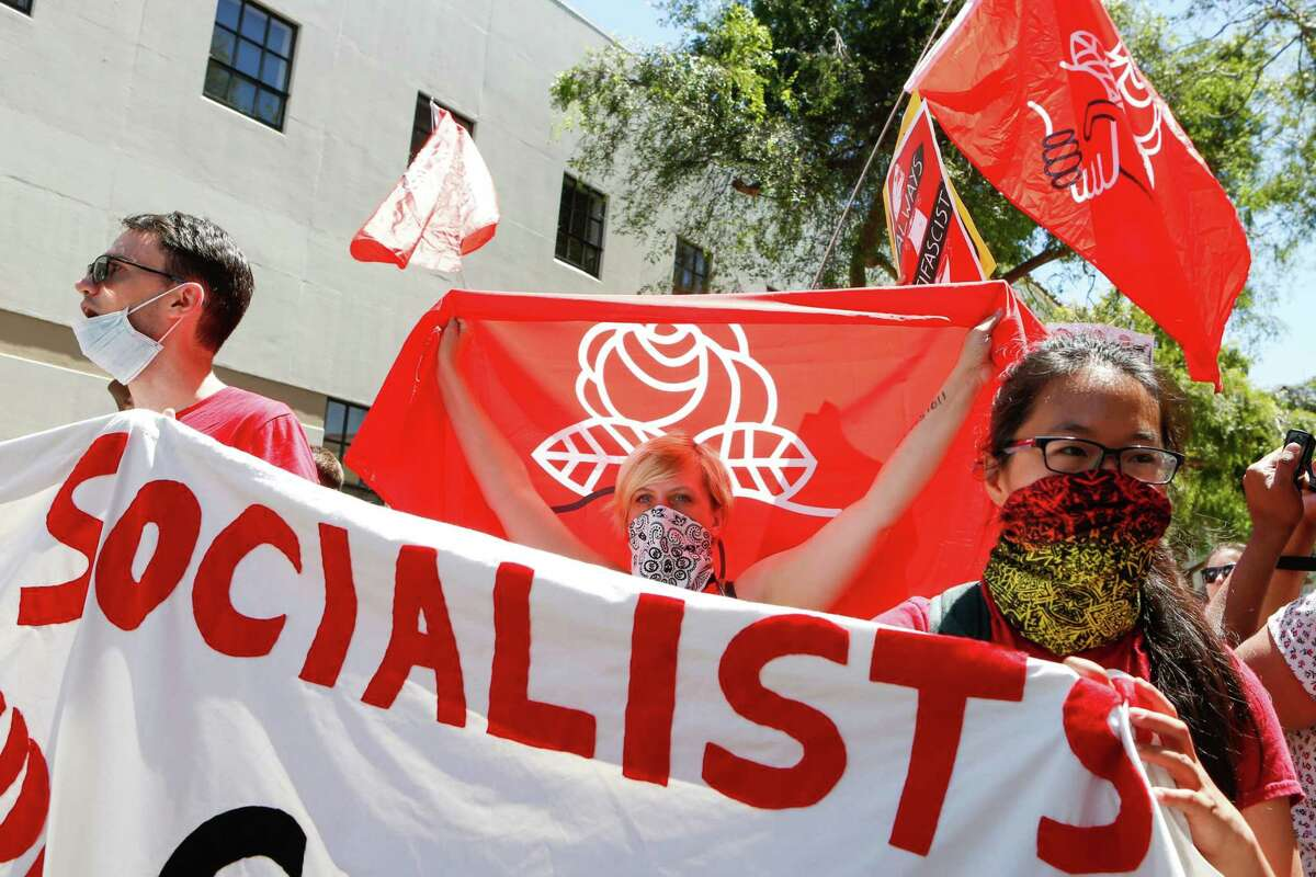 Democratic Socialists of America counter protesters hold signs and flags as they march, protesting an alt-right rally on August 5, 2018 in downtown Berkeley, California.. / AFP PHOTO / Amy OsborneAMY OSBORNE/AFP/Getty Images