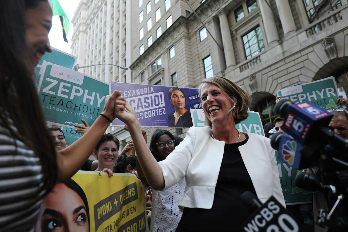 NEW YORK, NY - JULY 12: Congressional nominee Alexandria Ocasio-Cortez (L) stands with Zephyr Teachout after endorsing her for New York City Public Advocate on July 12, 2018 in New York City. The two liberal candidates held the news conference in front of the Wall Street bull in a show of standing up to corporate money. Ocasio-Cortez shocked the Democratic political community recently after an upset win against Representative Joe Crowley in the New York Democratic primary. (Photo by Spencer Platt/Getty Images)