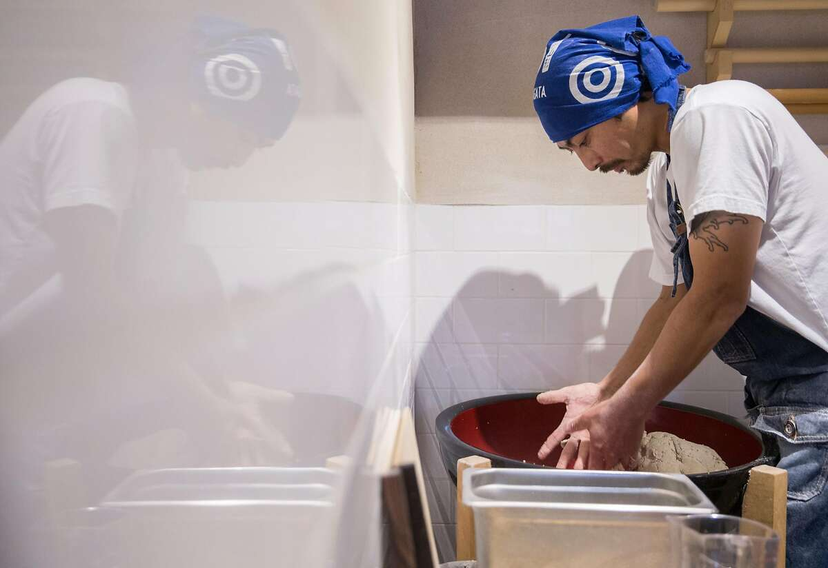 Koichi Ishii prepares the dough needed to create traditional hand made soba noodles in the early morning hours at Soba Ichi in Oakland, Calif. Wednesday, Aug. 15, 2018.