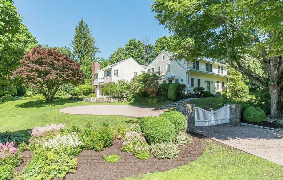 The 7,092-square-foot colonial-style home offers six bedrooms along with five full bathrooms and two half baths. Photo: Real Living Wareck D'Ostilio / ONLINE_CHECK