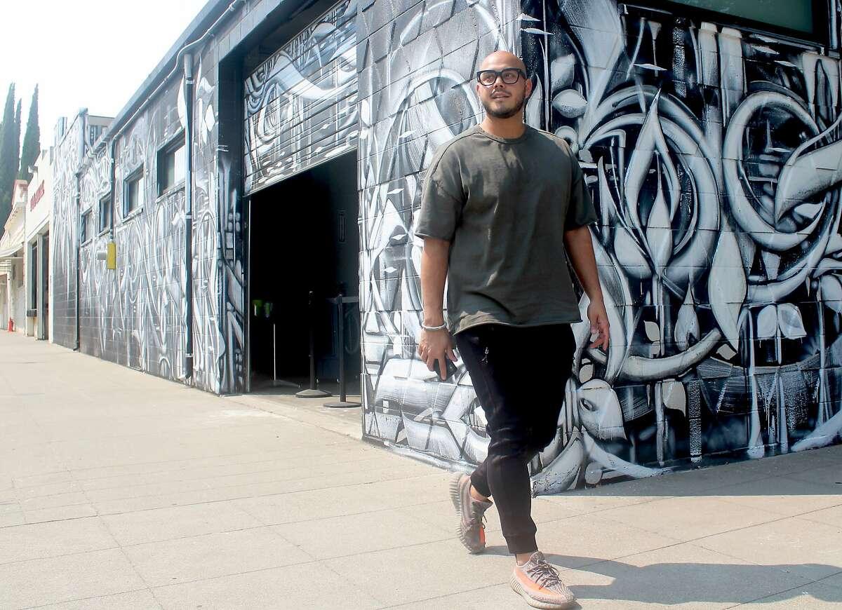 Performance painter David Garibaldi outside his R Street studio in Sacramento.