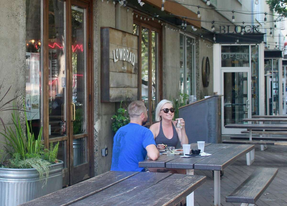 Nick Faulkner and acey Kaczmarcyk relax outside at Lowbrau, in Sacramento's Midtown.