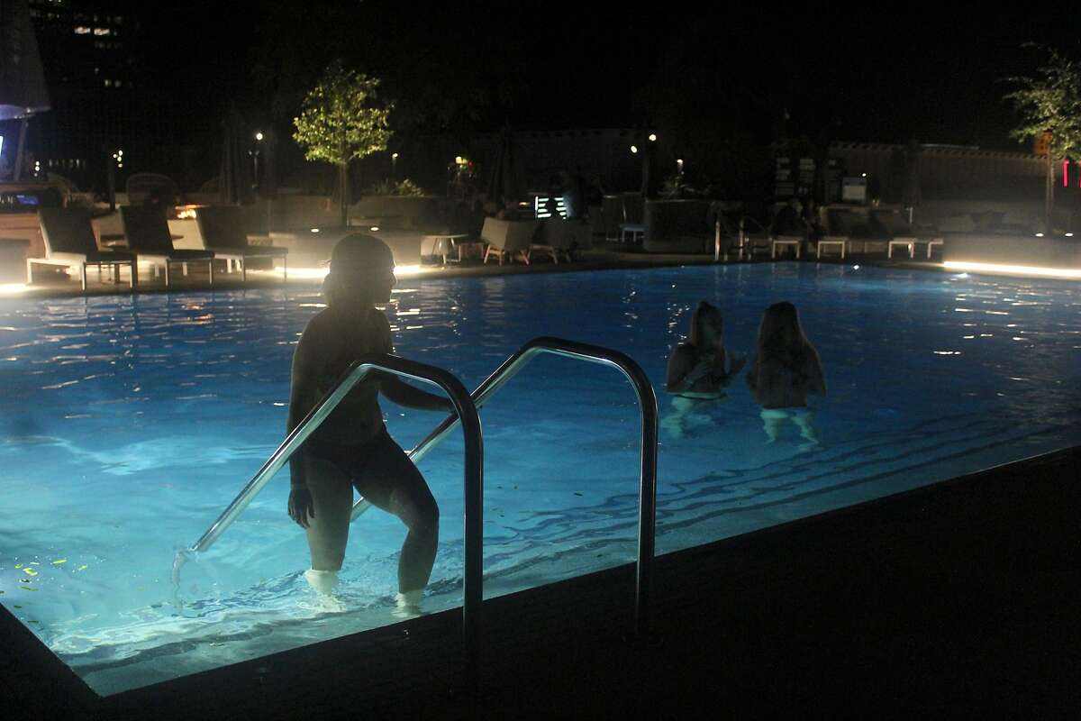 Sarah Kronenberg and friends enjoy an evening dip during Liquid Wednesday at Revival, outside on the third-floor deck at Sacramento's new Kimpton Sawyer Hotel.
