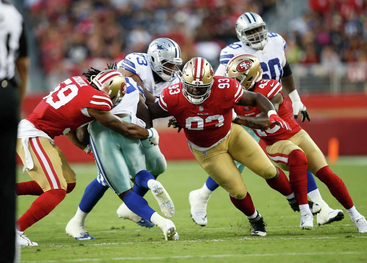 SANTA CLARA, CA - AUGUST 9: Korey Toomer #59 and D.J. Jones #93 of the San Francisco 49ers make a tackle during the game against the Dallas Cowboys at Levi Stadium on August 9, 2018 in Santa Clara, California. The 49ers defeated the Cowboys 24-21. (Photo by Michael Zagaris/San Francisco 49ers/Getty Images)