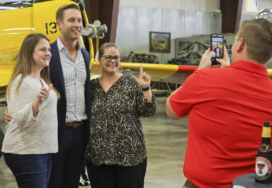 Texas Tech head football coach Kliff Kingsbury takes a picture 08/20/18 evening with Evan Saucedo and Alicia Hansford at the Red Raider Club dinner at the Midland CAF. Tim Fischer/Reporter-Telegram Photo: Tim Fischer/Midland Reporter-Telegram
