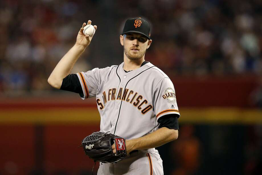 San Francisco Giants starting pitcher Chris Stratton pauses with the baseball during the first inning of a baseball game against the Arizona Diamondbacks Friday, Aug. 3, 2018, in Phoenix. (AP Photo/Ross D. Franklin) Photo: Ross D. Franklin / Associated Press