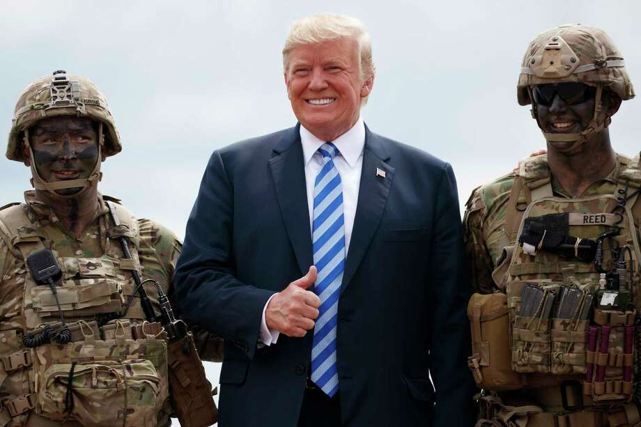"""President Donald Trump poses for a photo with participants of an air assault exercise at Fort Drum, N.Y., Monday, Aug. 13, 2018, before a signing ceremony for H.R. 5515, the """"John S. McCain National Defense Authorization Act for Fiscal Year 2019."""" (AP Photo/Carolyn Kaster) Photo: Carolyn Kaster / Copyright 2018 The Associated Press. All rights reserved."""
