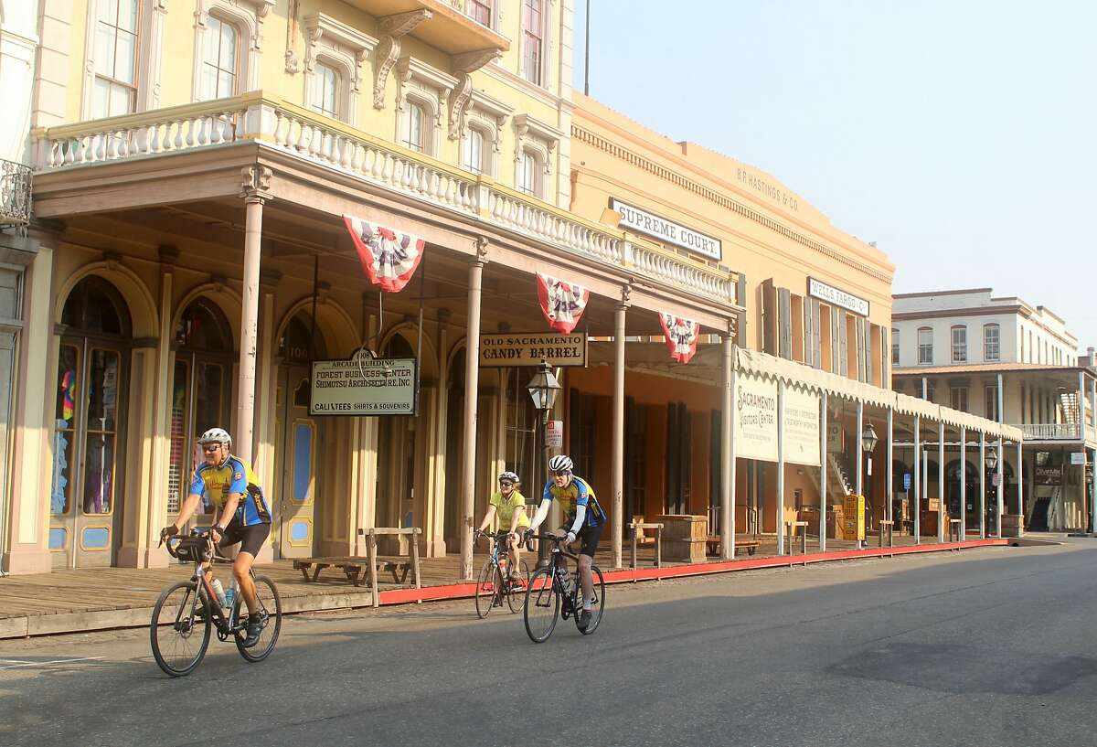 Riders from Sacramento's Bike Hikers cycling club pedal through Old Sacramanto State Historic Park.