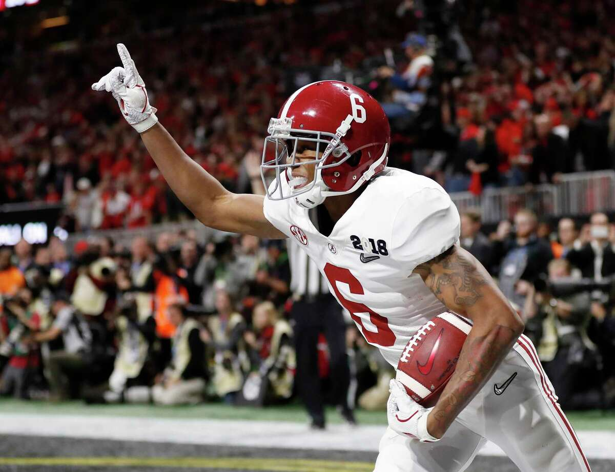 FILE - In this Jan. 8, 2018, file photo, Alabama wide receiver DeVonta Smith (6) celebrates his touchdown during overtime of the NCAA college football playoff championship game against Georgia, in Atlanta. The AP preseason Top 25 is out, and for the third straight year Alabama is No. 1. (AP Photo/David Goldman, File)