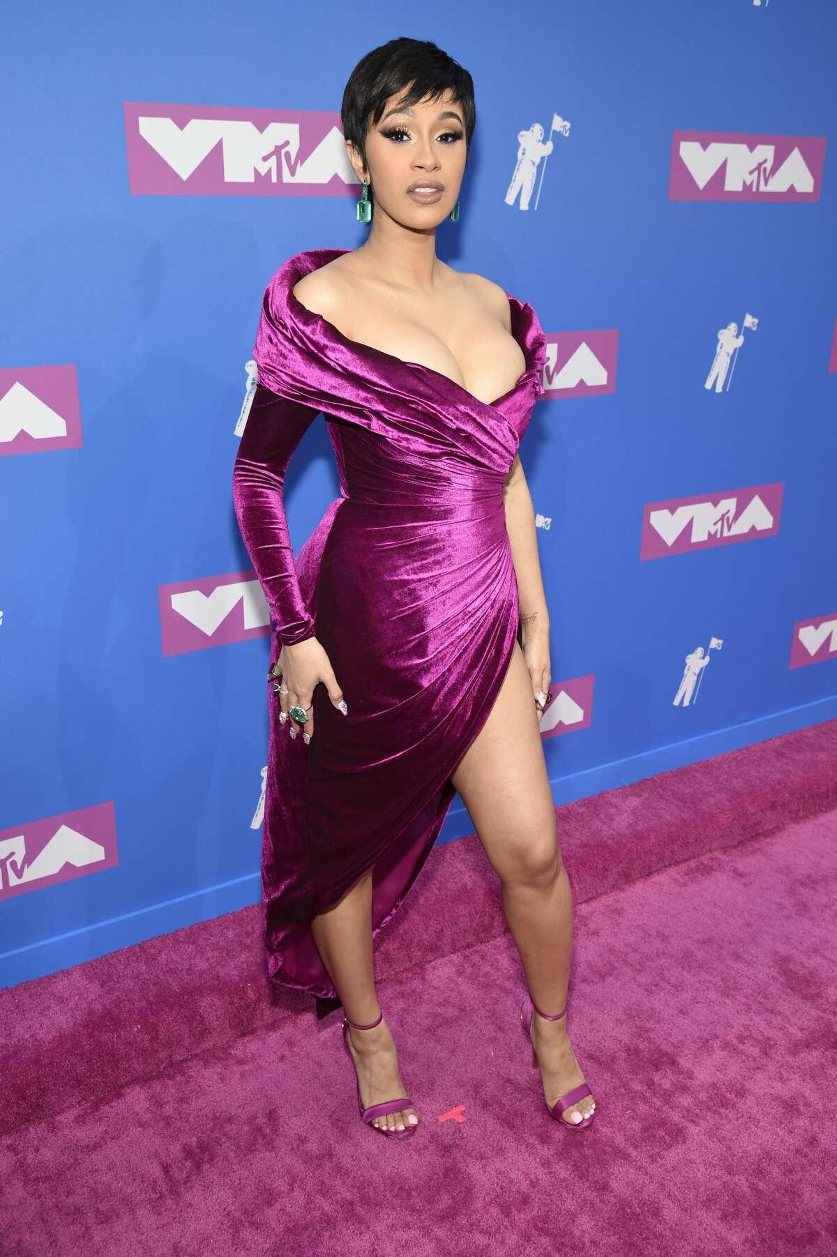 New mom Cardi B slayed in this royal purple dress.