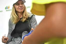 WTA tennis player Simona Halep, the No. 1 ranked player in the world, signs autographs Monday at the Connecticut Open at the Connecticut Tennis Center in New Haven.