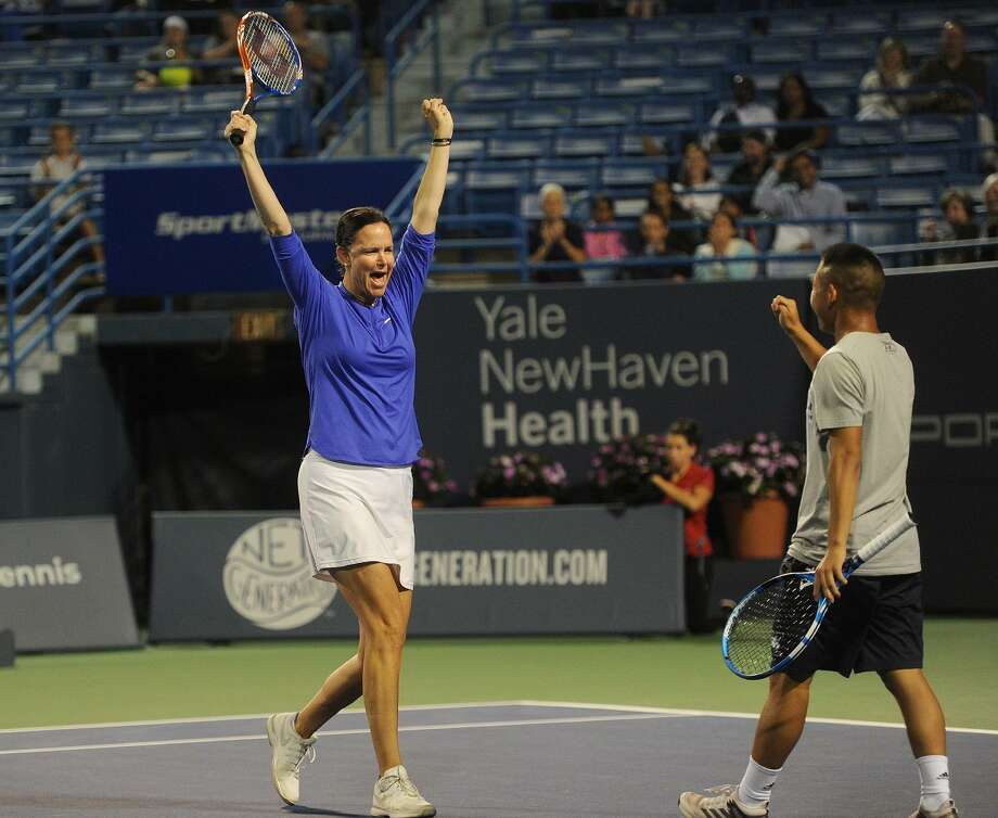 Lindsay Davenport celebrates with her mixed doubles partner, Yale tennis team member Michael Sun, 18, of Livingston, NJ, after a winning point in their match with James Blake and Yale partner Caroline Dunleavy, of Darien, at the Connecticut Open tennis tournament in New Haven, Conn. on Monday, August 20, 2018. Photo: Brian A. Pounds / Hearst Connecticut Media / Connecticut Post
