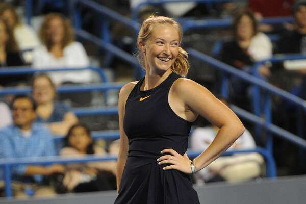 Yale tennis team member Caroline Dunleavy, 19, of Darien, smiles during her mixed doubles legends match with partner James Blake against Lindsay Davenport and Yale's Michael Sun, 18, of Livingston, NJ, at the Connecticut Open tennis tournament in New Haven, Conn. on Monday, August 20, 2018.