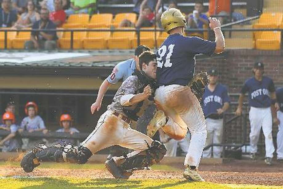 Wilmington, Del., Post 1's Matt Poma collides with Berryhill Post 165 catcher Nick Dardas in the top of the 10th inning in an American Legion World Series semifinal game on Monday at Veterans Field at Keeter Stadium in Shelby, N.C. (Photo by Lucas Carter / The American Legion)