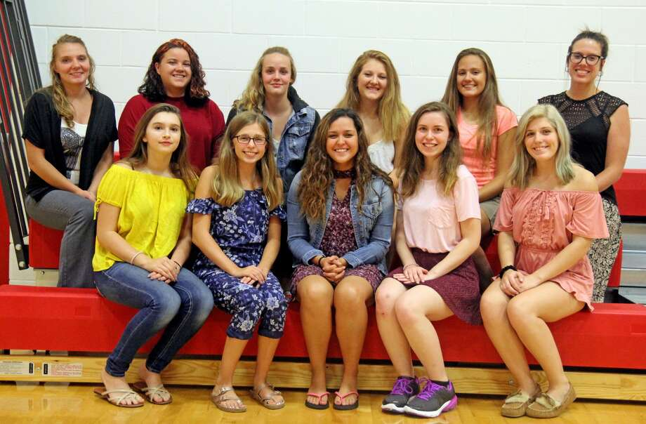 Members of the Caseville varsity volleyball team are (front row from left) co-coach Natasha Crawford Sears, Rayne Avalos, Alyssa Holland, Tyonna Ontiveros, Emma Hopkins and co-coach Samantha Krueger (back row) Nina Quintana, Adrian Ewald, Jessica Nugent, Becca Morgan and Timarie Kildow. (Mike Gallagher/Huron Daily Tribune) Photo: Mike Gallagher/Huron Daily Tribune