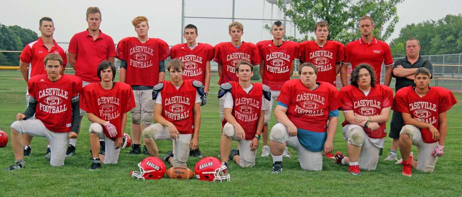 Members of the Caseville varsity football team are (front row from left) Dalton Shippey, Jack Ales, Nate Dufty, Chance Shippey, Schyler Newton, Blake Newton and Anthony Denean (back row) assistant coach Sam Rogers, assistant coach Adam Figurski, Kelly Rice, AJ Pattengill, Kevin Haag, Jacob Kennedy, Dominick Madison, assistant coach Frank Konke Jr. and head coach Craig Newton. (Mike Gallagher/Huron Daily Tribune) Photo: Mike Gallagher/Huron Daily Tribune