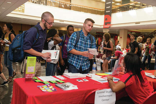Nathan Cauley (left), of Bunker Hill, and Logan Siekmann, of Troy, visit with a representative from the Kimmel Student Involvement Center during the SIUE Resource Fair.