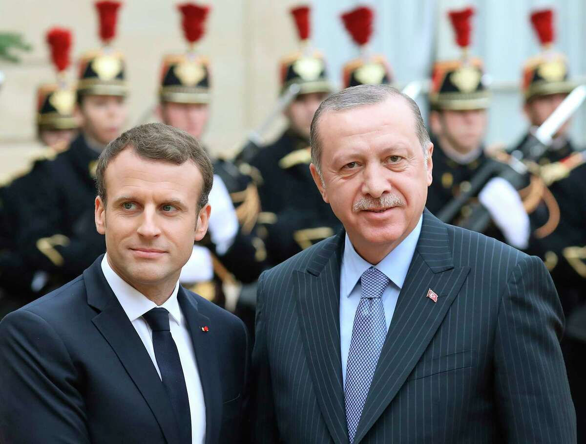 (FILES) In this file photo taken on January 5, 2018 French President Emmanuel Macron (L) welcomes his Turkish counterpart Recep Tayyip Erdogan upon his arrival for their meeting and luncheon at the Elysee palace in Paris. - Turkish President Recep Tayyip Erdogan and his French counterpart Emmanuel Macron agreed in a phone call on August 16, 2018, to foster trade ties, a Turkish presidential source said, after the lira's dramatic fall in the wake of escalating tensions with the US. (Photo by LUDOVIC MARIN / AFP)LUDOVIC MARIN/AFP/Getty Images