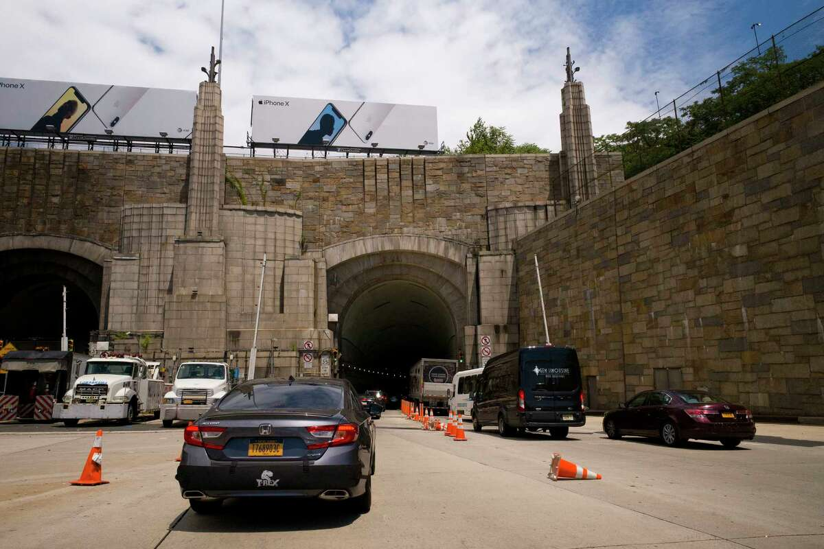 FILE - In this June 21, 2018, file photo, traffic on Route 495 enters the Lincoln Tunnel en route to New York City, in Weehauken, N.J. Monday, Aug. 20 marks the first full weekday of lane closures on the approach to the Lincoln Tunnel, part of a 2 1/2-year project that will rebuild an aging bridge and roadway - and cause severe congestion in an area that already is one of the northeastern U.S's worst bottlenecks. (AP Photo/Mark Lennihan, File)
