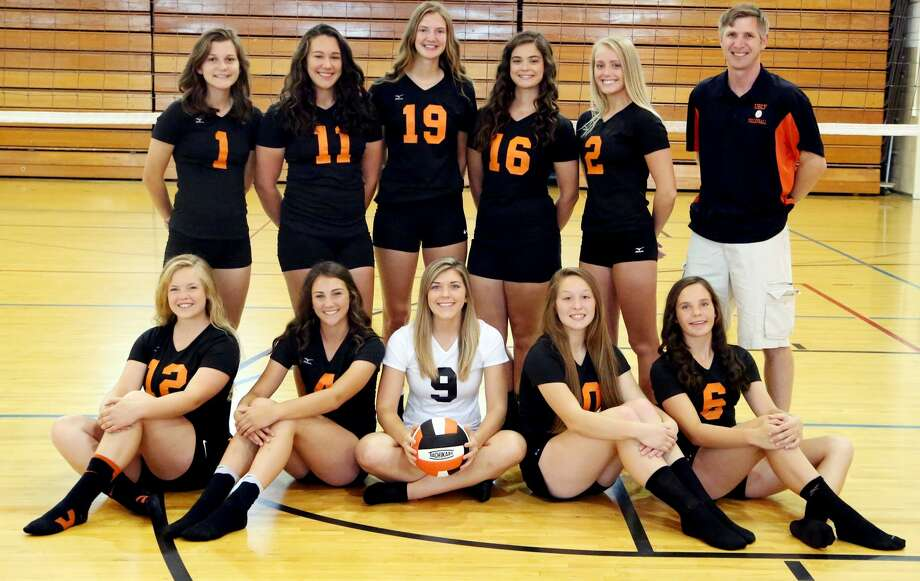 Members of the Ubly varsity volleyball team are (front row from left) Mikaela VanErp, Samantha Souva, Cheyenne Janik, Abigail Soreson and Josie Gusa (back row) Kelsey Knoblock, Sadie Souva, Lindsey Guza, Amanda Weaver, Natalie Pallas and coach Aaron Mueller. (Paul P. Adams/Huron Daily Tribune) Photo: Paul P. Adams/Huron Daily Tribune