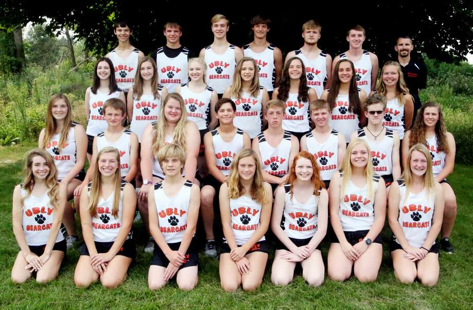 Members of the Ubly cross country team are (front row from left) Grace Conley, Shelby Messing, Dawson Schumacher, Alexiss Guigar, Alexia Vogel, Andrea Grifka and Jaiden Schulte (second row) Sabrina Schumacher, Theron Harris, Isle Roggenbuck, Grant Geiger, Gabe Sweeney, Seth Schumacher, Ethan Sabins and Bethany Gornowicz (third row) Madelyn Peplinski, Cheyenne Porzondek, Lauren Dropeski, Emily Winkel-Fritz, Josie Gusa, Haili Gusa and Danielle Tschirhart (back row) Isaac Booms, Ryche Roggenbuck, Zachary Garner, Cole Hagen, Tanner Wollin, Josh Brandel and coach Garrett Jurges. Missing are Kate Garner, Kylie Ogryski and Sierra Walker. (Paul P. Adams/Huron Daily Tribune) Photo: Paul P. Adams/Huron Daily Tribune