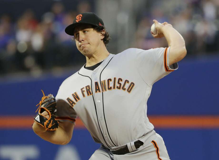 San Francisco Giants' Derek Holland delivers a pitch during the first inning of a baseball game against the New York Mets Monday, Aug. 20, 2018, in New York. (AP Photo/Frank Franklin II) Photo: Frank Franklin II, Associated Press