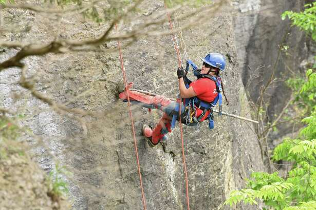 A female member of New York State Parks Recreation & Historic Preservation scaling team rappels down the rocky cliff above Indian Ladder Trail at John Boyd Thacher State Park on Thursday, May 31, 2018 in Voorheesville, N.Y. The scaling team, out of Ithaca, was poking loose rocks to make them fall to prevent future injuries to hikers. (Lori Van Buren/Times Union)
