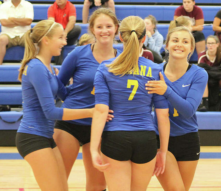 Roxana's (from left) Macie Lewis, Darcey McGuire, Taylor Jackson (7) and Abby Kurth celebrate a point against Calhoun on Monday at the Roxana Tourney. Photo:       Greg Shashack / The Telegraph