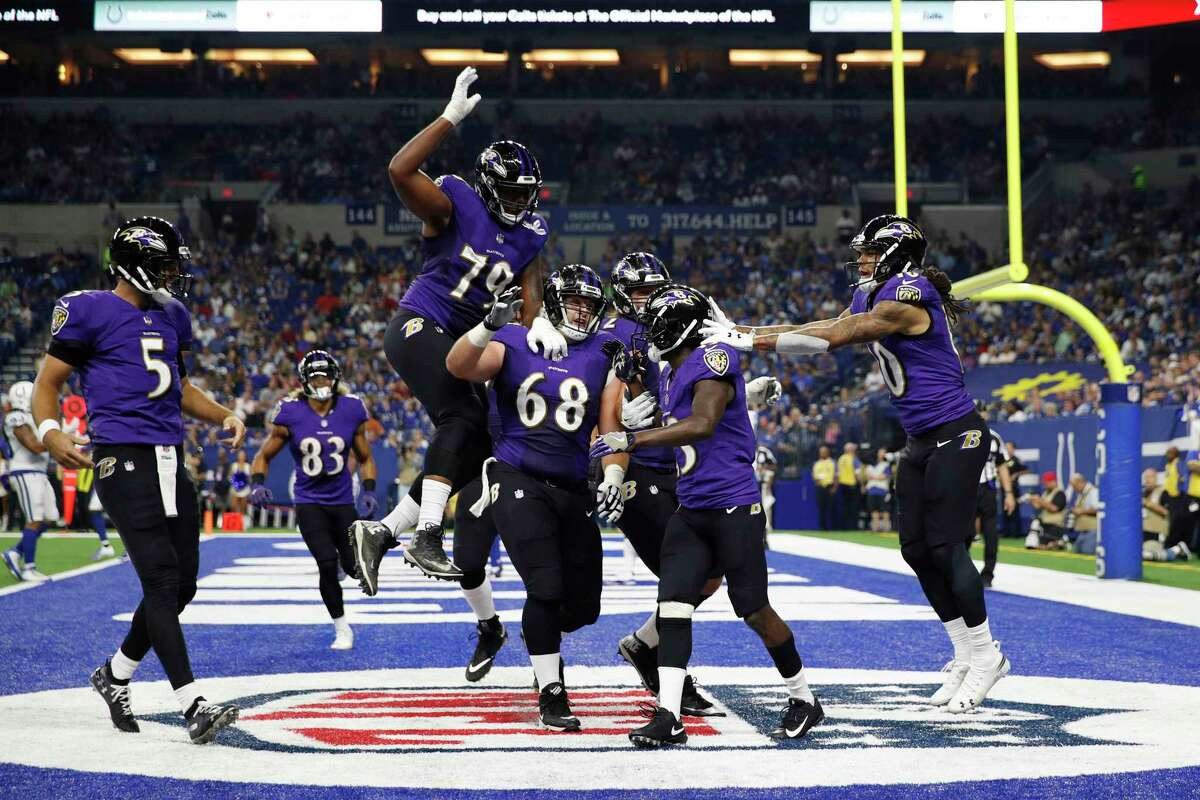 INDIANAPOLIS, IN - AUGUST 20: John Brown #13 of the Baltimore Ravens celebrates with teammates after a seven-yard touchdown reception against the Indianapolis Colts in the second quarter of a preseason game at Lucas Oil Stadium on August 20, 2018 in Indianapolis, Indiana. (Photo by Joe Robbins/Getty Images)