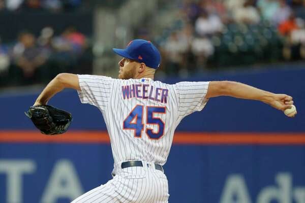 New York Mets' Zack Wheeler delivers a pitch during the first inning of a baseball game against the San Francisco Giants Monday, Aug. 20, 2018, in New York. (AP Photo/Frank Franklin II)