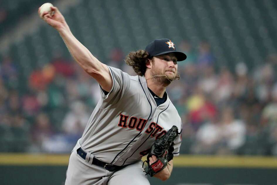 SEATTLE, WA - AUGUST 20: Gerrit Cole #45 of the Houston Astros pitches against the Seattle Mariners in the first inning during a game at Safeco Field on August 20, 2018 in Seattle, Washington.