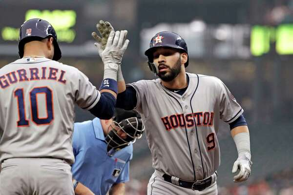 Houston Astros' Marwin Gonzalez (9) is congratulated on his solo home run by Yuli Gurriel against the Seattle Mariners in the first inning of a baseball game Monday, Aug. 20, 2018, in Seattle. (AP Photo/Elaine Thompson)