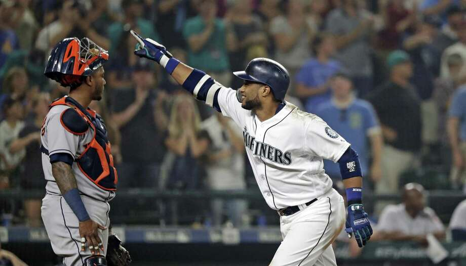 Robinson Cano, who has made a point of piling up RBIs against the Astros in recent seasons, crosses the plate to the dismay of catcher Martin Maldonado after hitting a tiebreaking three-run homer for the Mariners in the eighth inning Monday night. Photo: Elaine Thompson, STF / Associated Press / Copyright 2018 The Associated Press. All rights reserved