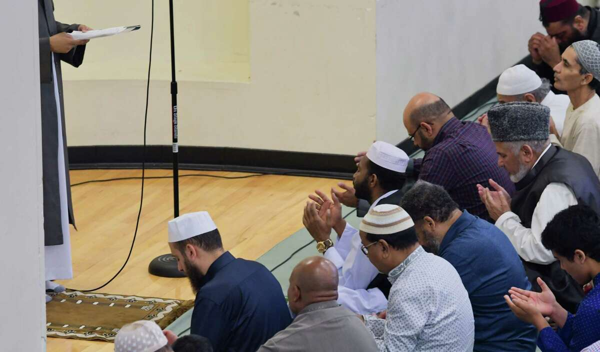 Mosques in the Capital Region canceled services on Friday amid concern about the coronavirus. In this photograph, Muslims gather for prayers to celebrate Eid ul Adha at the Islamic Center of the Capital District on Tuesday, Aug. 21, 2018, in Colonie, N.Y. (Paul Buckowski/Times Union)