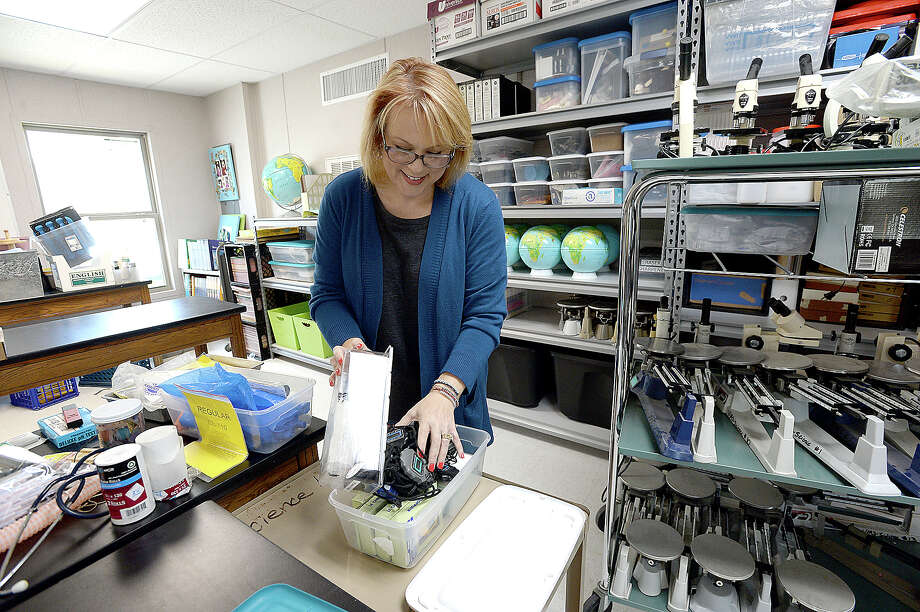 Sixth grade science teacher Robin James shelves microscopes and other equipment as she begins preparing her room in the new portables which will serve sixth graders and staff at the Vidor Junior High School campus. Fifth graders will be in portables at the high school. The middle school was one of two campuses Vidor ISD lost in Harvey's flooding, and the district is still awaiting word from FEMA on how much they will receive to remodel or build anew. The 10 portable units started arriving in June, and construction crews have been putting them together within the last two weeks, doing the plumbing and electrical work and building covered walkways connecting the units. Last year, the district shuffled its two closed campuses among other school buildings, sharing rooms and other facilities in the wake of Harvey's flooding. This year, sixth graders will be at the portables, which they anticipate will be the case for at least 2 years.  Monday, August 20, 2018 Kim Brent/The Enterprise Photo: Kim Brent/The Enterprise