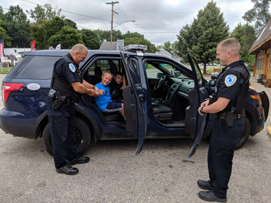 Gladwin police take part in cone with a cop at the Bear Den Ice Cream Shop. Photo: Tereasa Nims/for The Daily News